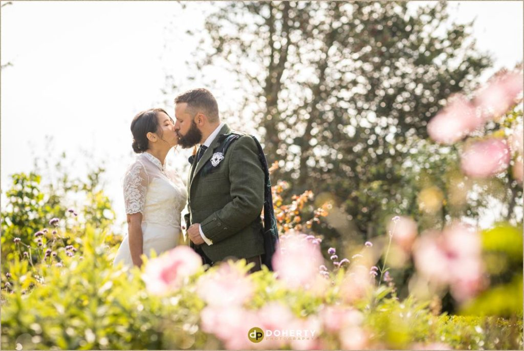 wedding couple in gardens at Lord Leycester Hospital