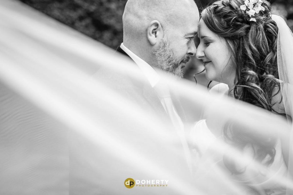 Ansty Hall bride and groom with veil blowing in the wind