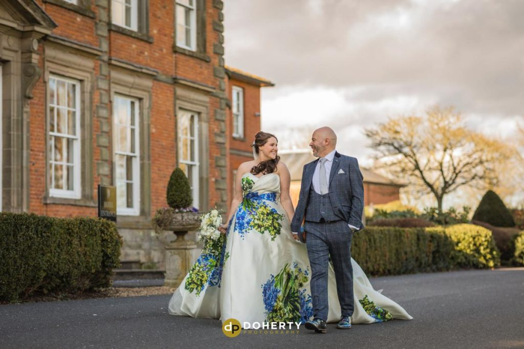 Bride and Groom walking at Ansty Hall in Coventry