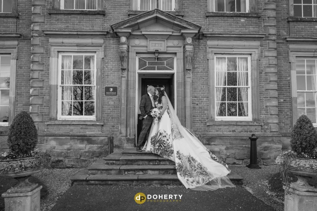 Bride and Groom at entrance to Ansty Hall