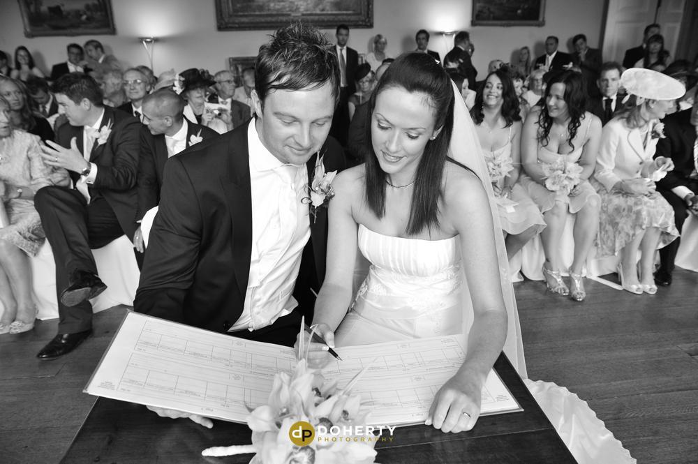 Kelmarsh Hall couple signing register