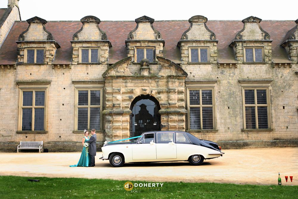 Bolsover Castle wedding couple with car