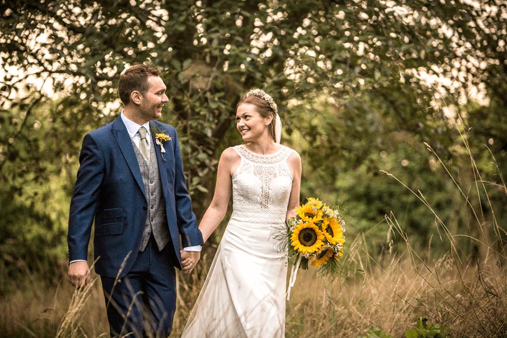 Cotswolds wedding couple walking