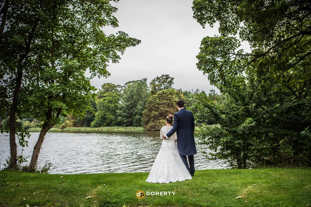 Luton Hoo wedding couple at a lake