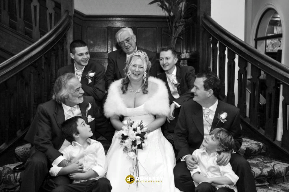 Bridal party on the staircase at Laura Ashley - The Iiffe Hotel