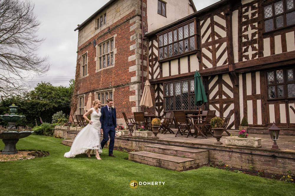 Albright Hussey wedding venue with bride and groom walking