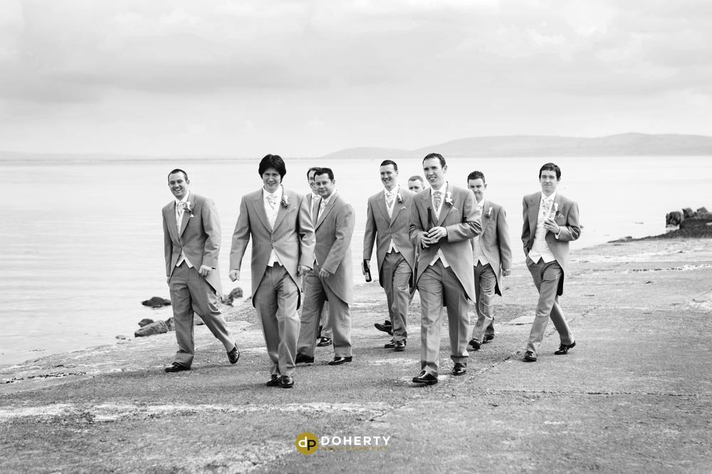 Destination wedding with groomsmen on beach