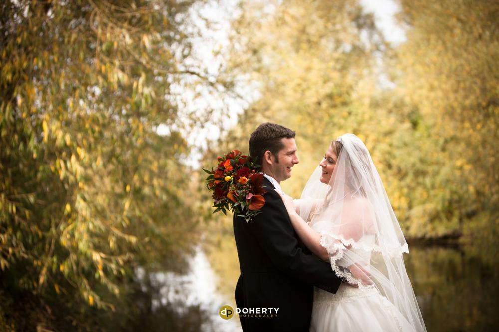 Quorn Country Hotel with bride and groom by the river- Leicestershire Photographer