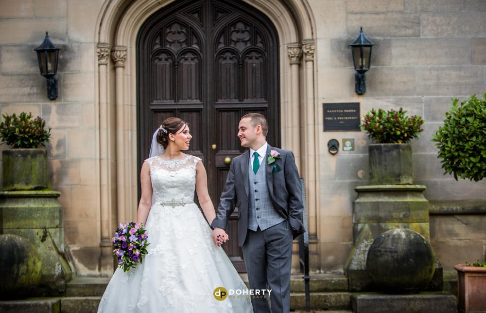 Hampton Manor wedding bride and groom at entrance