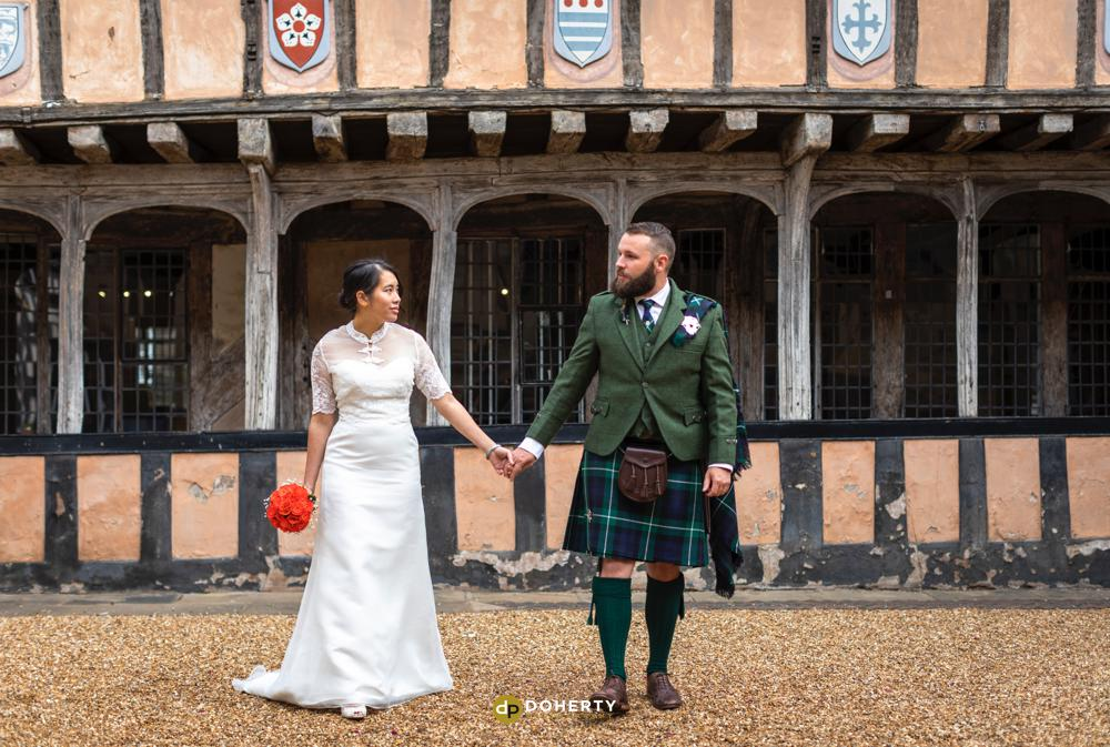 Bride and Groom in courtyard at Lord Leycester Hospital