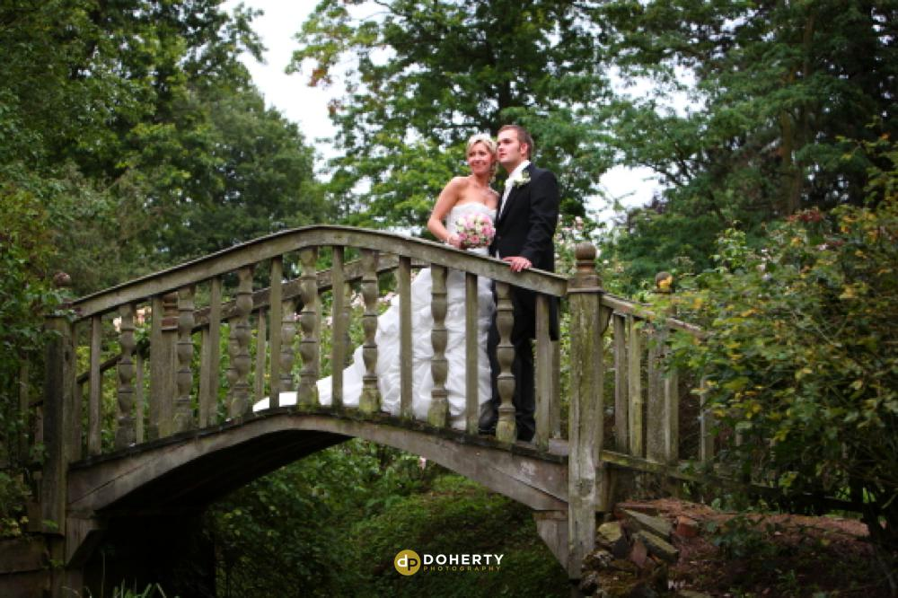 Bridge at Whatton House with bride and Groom