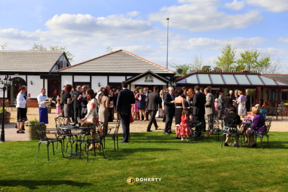 Stanwick Hotel wedding venue with guests outside