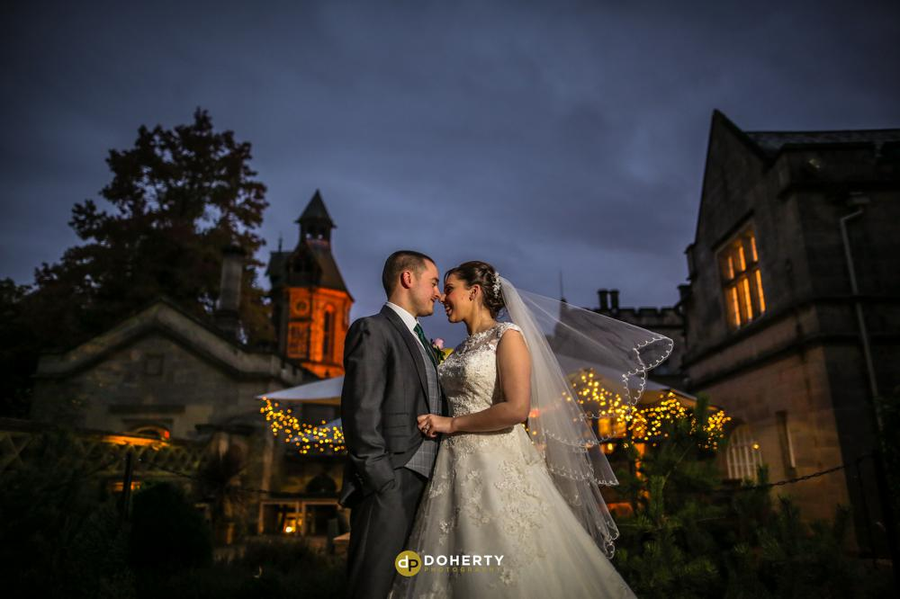 Bride and groom at Hampton Manor at night time