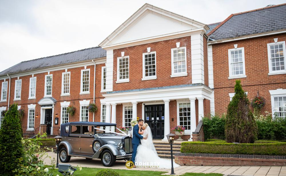 Windmill Village Hotel in Meriden with bride and groom with wedding car