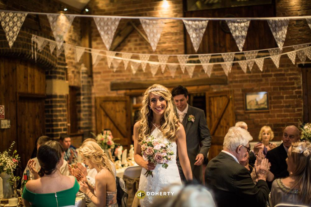 Wishaw Country Sports Barn with entrance of Bride and Groom