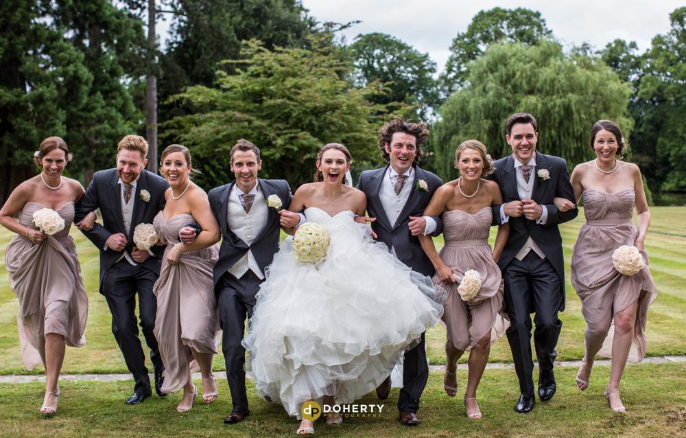 Alcott wedding bridal party running