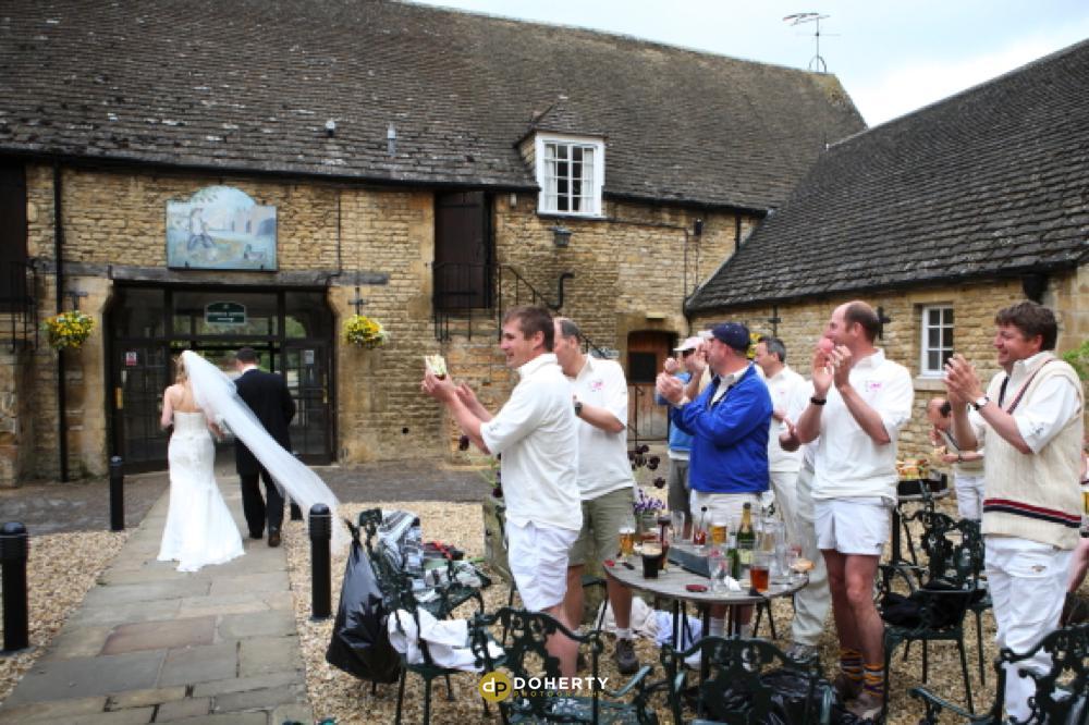 Haycock Hotel bride and groom enter - Cambridgeshire Wedding Photography