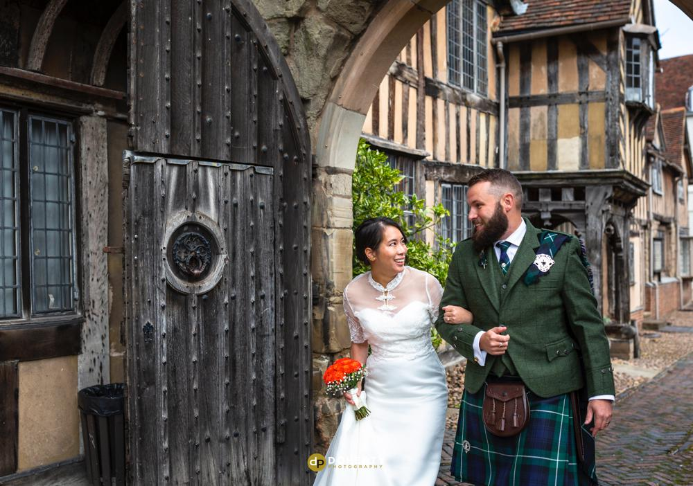 Bride and groom entering Lord Leycester Hospital in Warwick