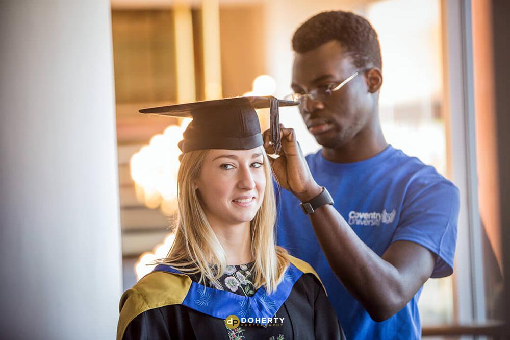 University Graduate preparing for her ceremony