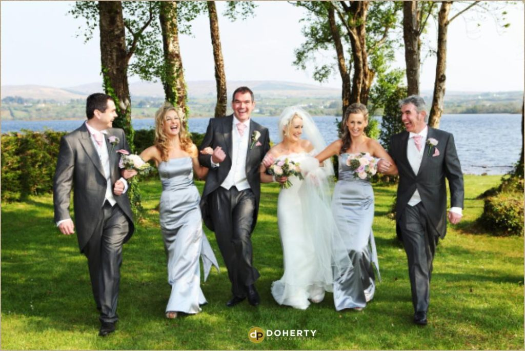 Wedding bridal party in Ireland by lake