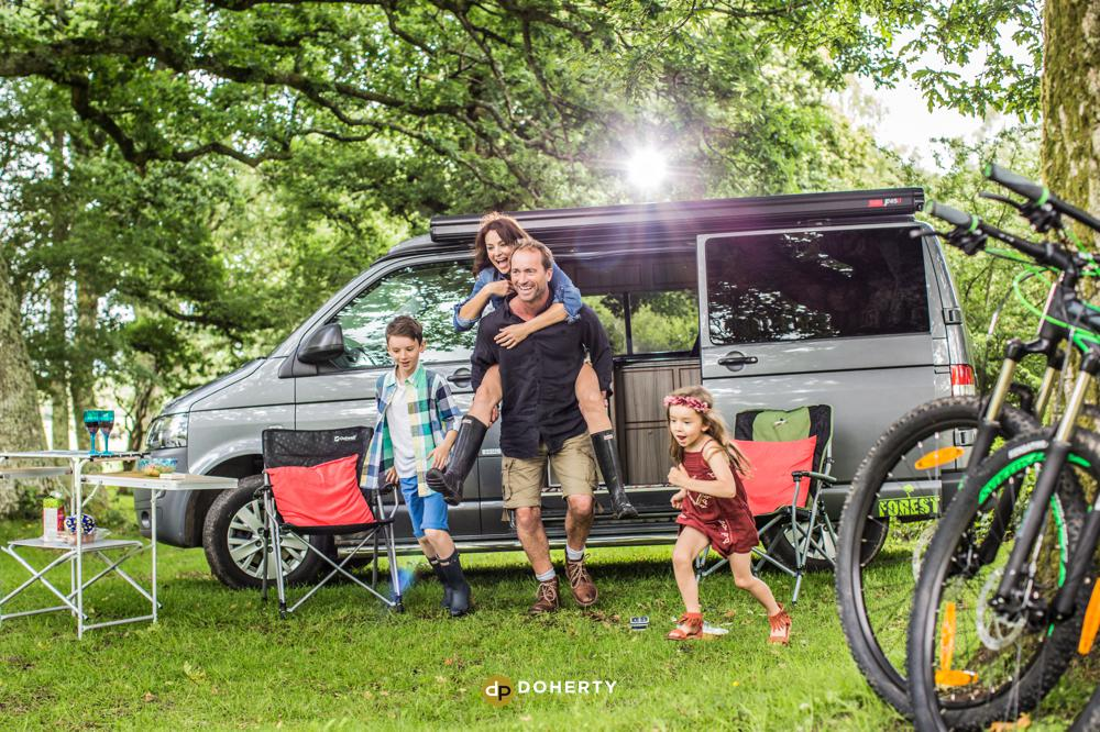 camper van and family in the outdoors