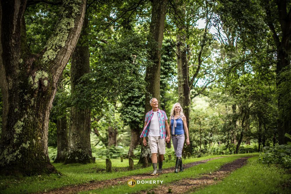older couple walking through woods