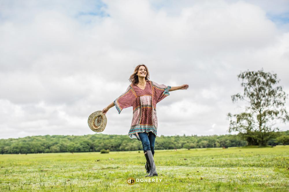 Woman joyfully walking in fields