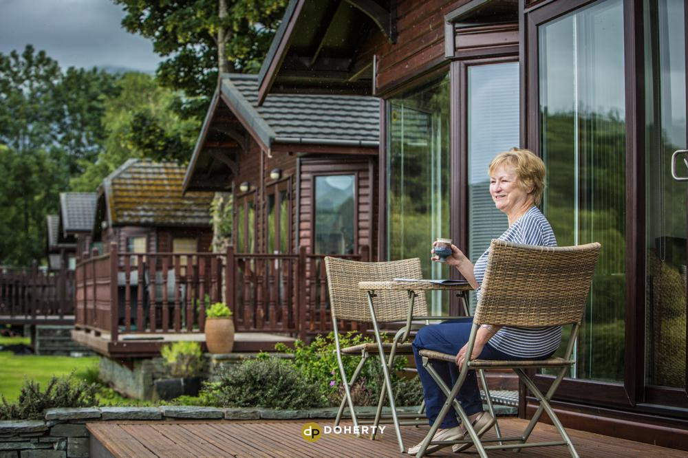 Lady sitting outside her lodge cabin