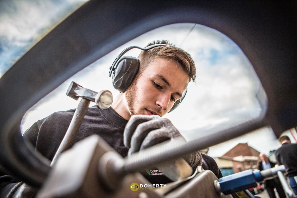 Apprentice working on engineering tools