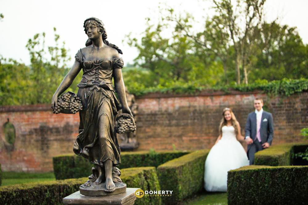 Nuthurst Grange Wedding couple in the gardens