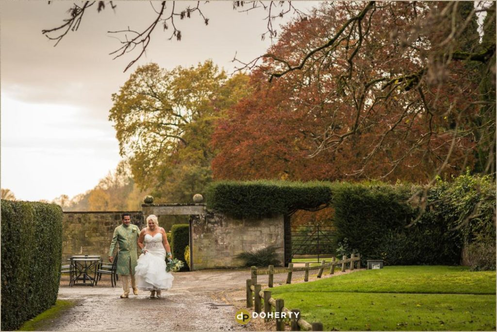 Coombe Abbey venue with bride and groom