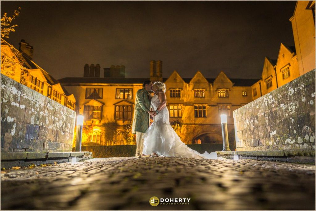 Coombe Abbey with bride and groom at night