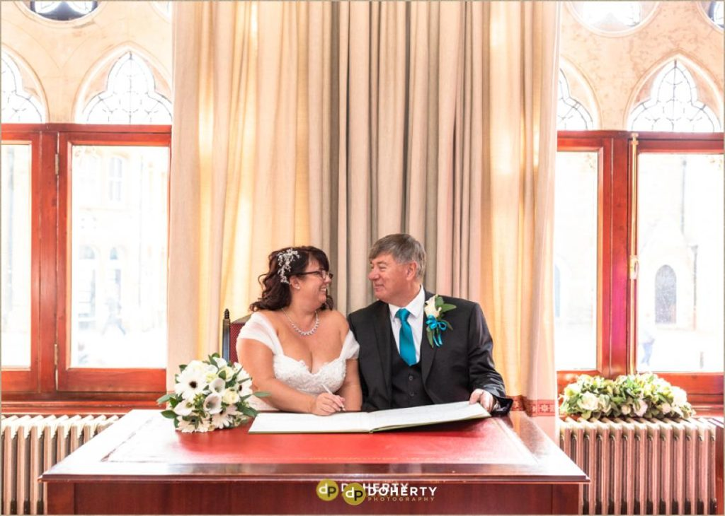Northampton Guildhall Wedding Photography with couple signing the registrar