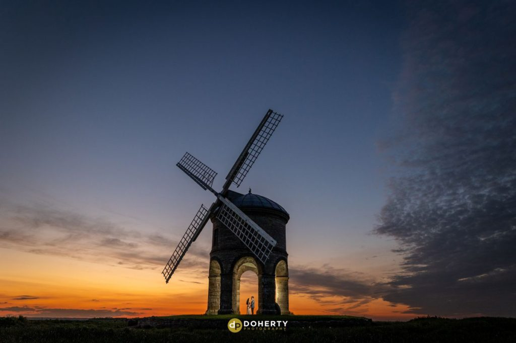 Wedding couple at Chesterton Windmill in Warwickshire at Sunset