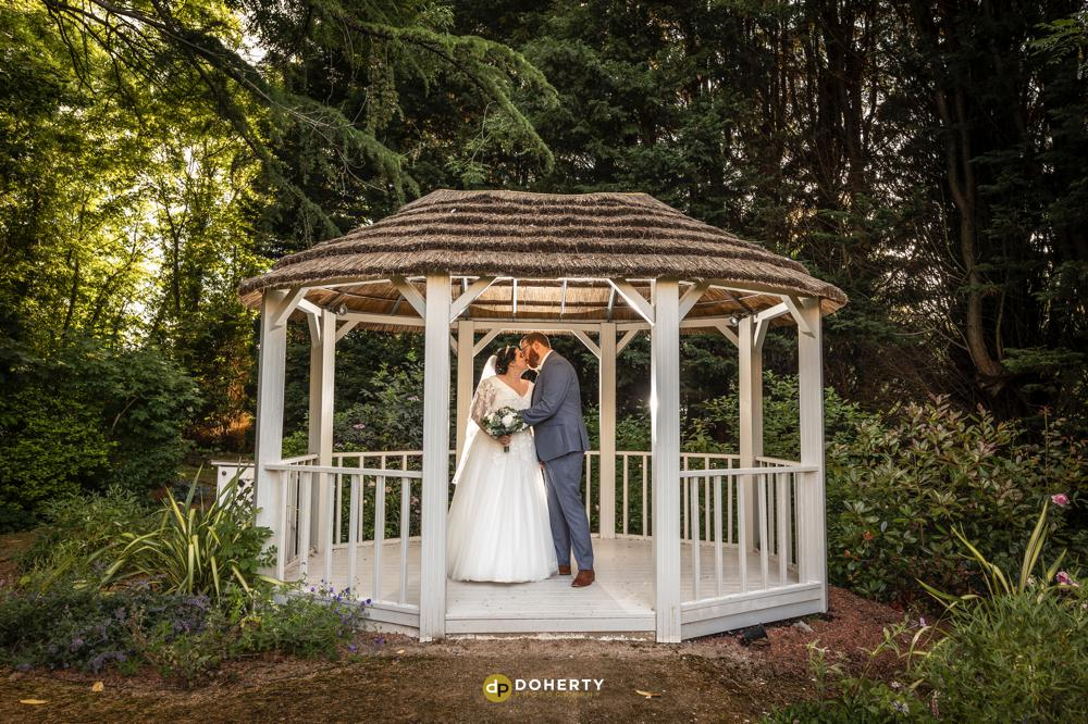 Bride and Groom in gardens at Laura Ashley Iliffe Hotel