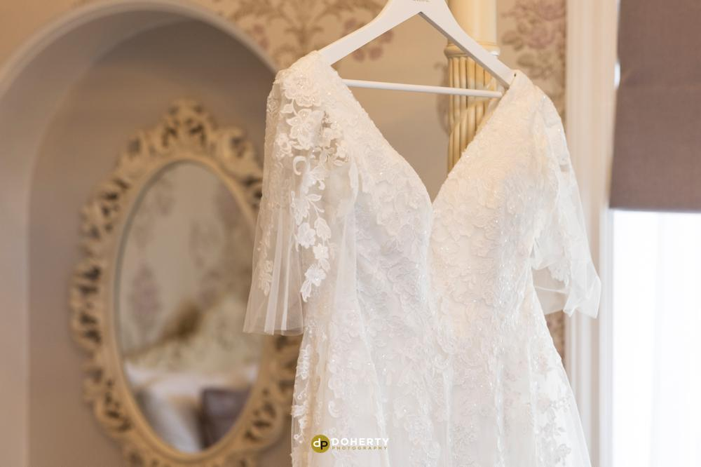 Wedding dress hanging up at Iliffe Hotel in Coventry