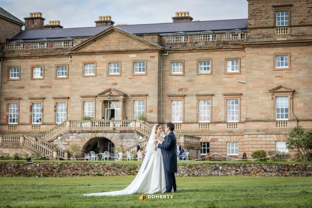weddign couple at Hagley Hall in Worcestershire