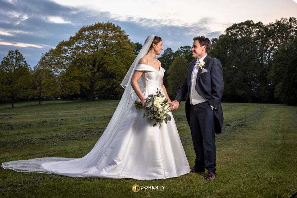 Bride and Groom in gardens at Hagley Hall