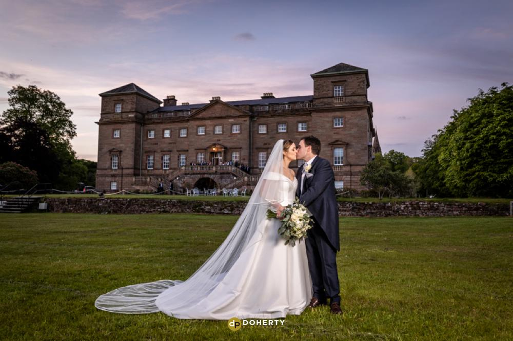 Bride and Groom outside Hagley Hall in gardens