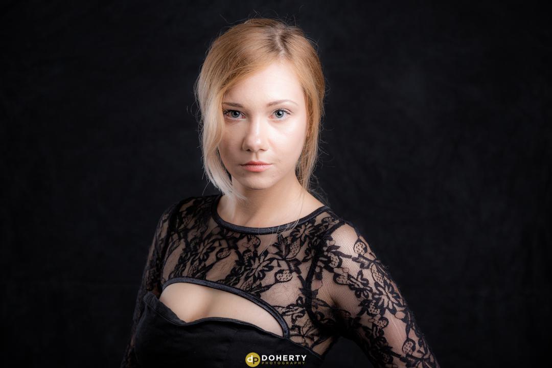 Studio portraits of woman in black dress
